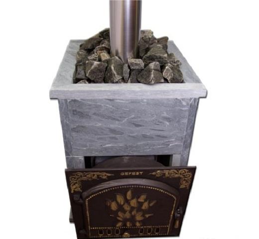На фото чугунная печь для бани фирмы Гефест
