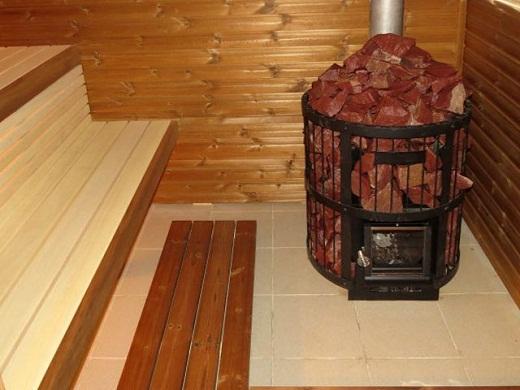 На фото представлена печь каменка для бани