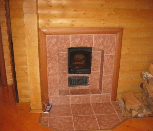 На снимке пример оформления печи в бане плиткой